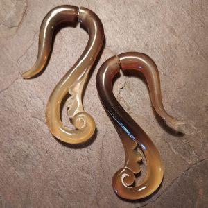 hand carved spellstone amber horn earring