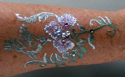 body art using Pros-Aide Adhesive and gilding powders