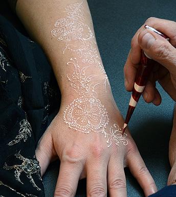 application of Becoming Moonlight 'white henna' body art